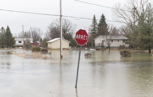 A residential street is shown surrounded by floodwaters in the town of Rigaud, Que. west of Montreal...