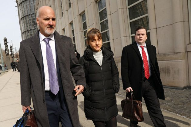 Actress Allison Mack leaves the Brooklyn Federal Courthouse with her lawyers after a court appearance...
