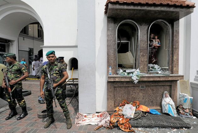 Sri Lankan military officials stand guard in front of the St. Anthony's Shrine, Kochchikade church after...