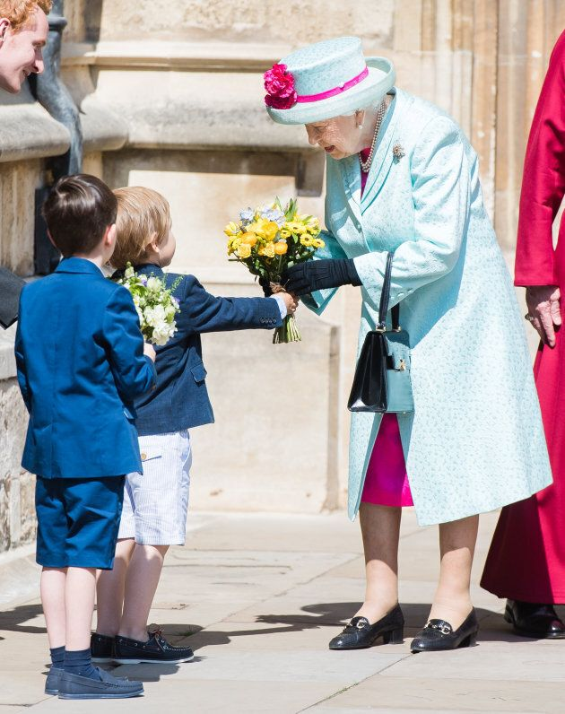 Queen Elizabeth II receives flowers at the Easter Sunday service at St George's Chapel.