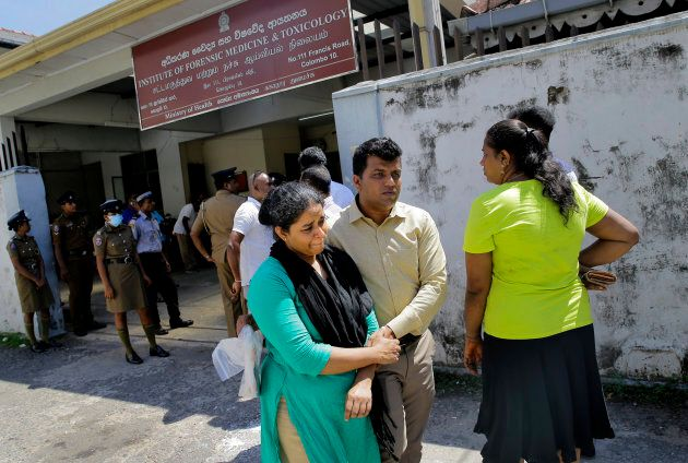 A Sri Lankan couple, whose family member was killed in an Easter Sunday blast, leaves from a mortuary...