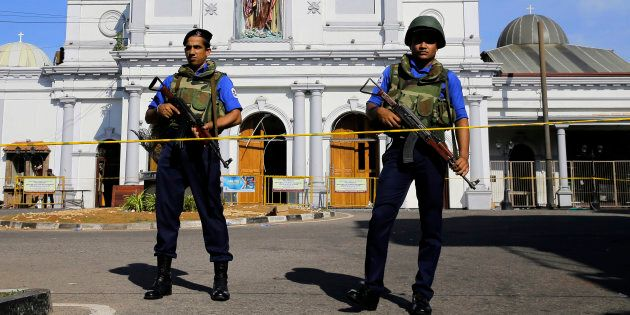Sri Lankan Navy soldiers stand guard in front of the St. Anthony's Shrine a day after the series of blasts...