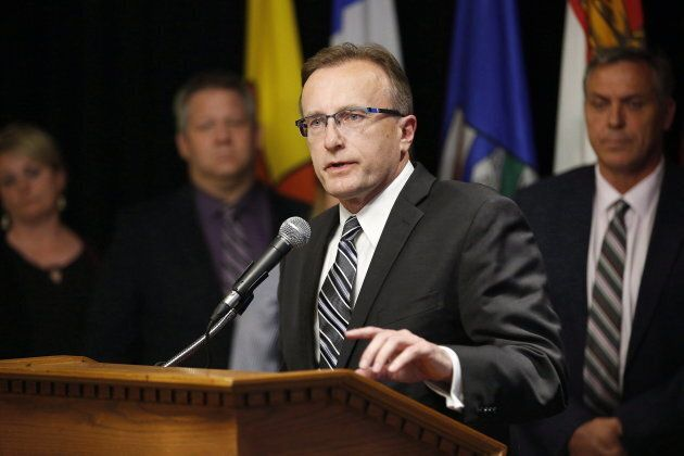 Jim Reiter, Saskatchewan Minister of Health, responds to a reporter's questions at a press conference...