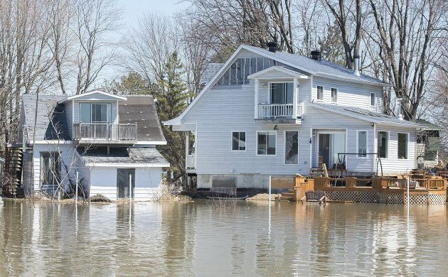Homes surrounded by floodwaters are shown with a view from the Ottawa River in the town of Rigaud, Que,...