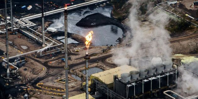 Flames shoot from a flare at the Suncor Energy Inc. Millennium upgrader plant in this aerial photograph...