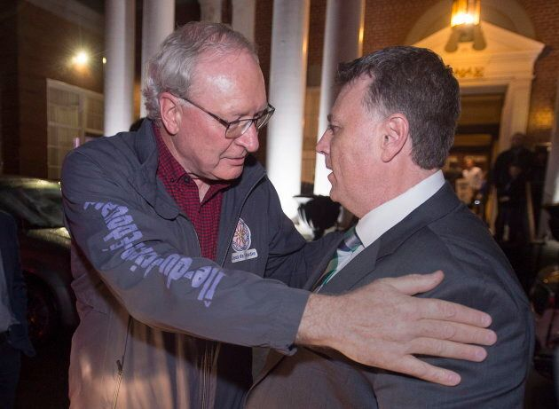 Premier Wade MacLauchlan greets Dennis King after King won the Prince Edward Island provincial election...