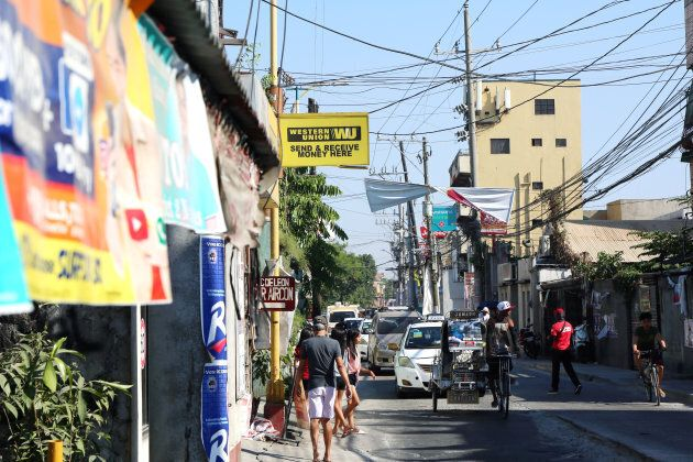 Filipinos abroad routinely send money home through money transfer companies like Western Union, seen here in a low-income community of Manila.