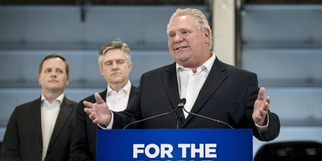 Ontario Premier Doug Ford gives remarks at a car dealership alongside MPP Jeff Yurek and provincial Environment...
