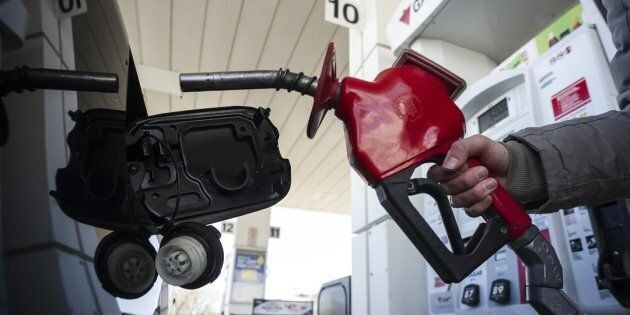 A woman fills up her with gas in Toronto, on April 1,