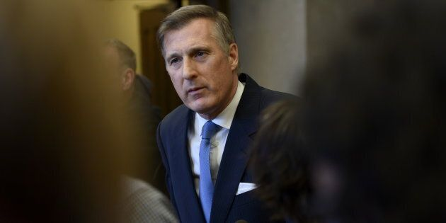 Maxime Bernier, leader of the People's Party of Canada, speaks to reporters in the House of Commons on Parliament Hill in Ottawa on March 19, 2019.