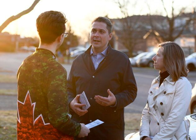 Conservative Leader Andrew Scheer speaks to a resident with Kanata—Carleton candidate Justina McCaffrey, right, during a door knocking event in the Kanata suburb of Ottawa on  April 25, 2019.