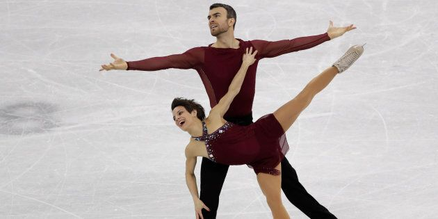Meagan Duhamel and Eric Radford perform in the pairs free skate figure skating final in the Gangneung Ice Arena at the 2018 Winter Olympics in South Korea, Feb. 15, 2018. On Friday, Duhamel announced she is pregnant.