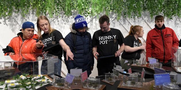 Customers and staff at the Hunny Pot Cannabis Co. retail cannabis store in Toronto, April 1. Less than...