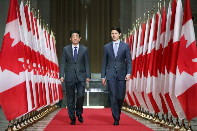 Japan's Prime Minister Shinzo Abe and Canada's Prime Minister Justin Trudeau arrive at a news conference...