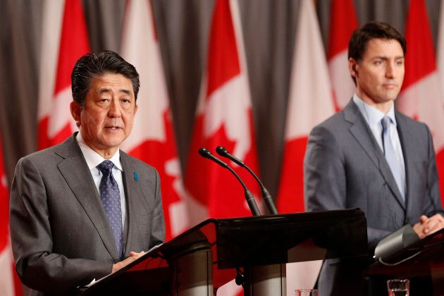 Japanese Prime Minister Shinzo Abe and Canadian Prime Minister Justin Trudeau answer questions during...