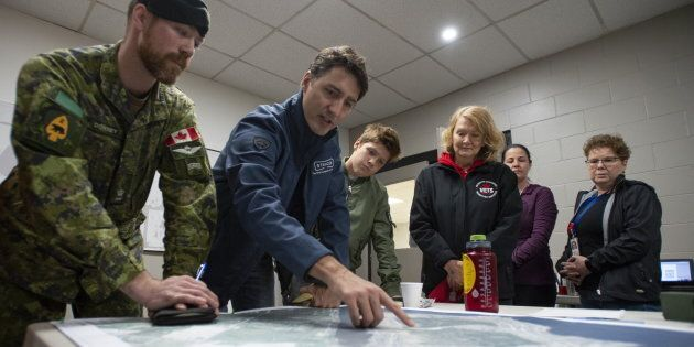 Prime Minister Justin Trudeau attends a briefing with members of the Canadian Forces on their response...