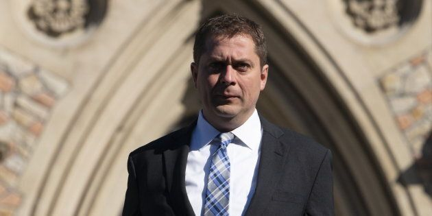 Andrew Scheer makes his way to a news conference in Ottawa on April 29,