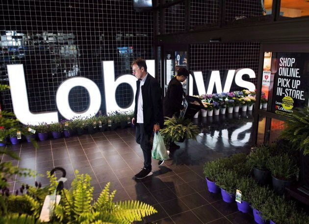 File photo of a shopper leaving a Loblaws store in Toronto on May 3, 2018.