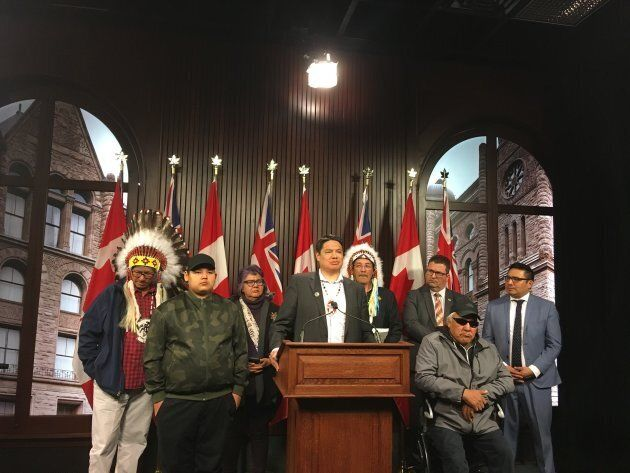 Derek Fox, deputy grand chief of Nishnawbe Aski Nation, speaks at Queen's Park on April 29, 2019, surrounded by community leaders, MPPs and members of Kashechewan First Nation.