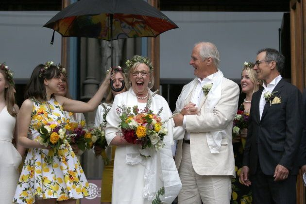 May and Kidder greet the crowd as her daughter Cate holds an umbrella at the Christ Church Cathedral in Victoria, B.C., on April 22, 2019.