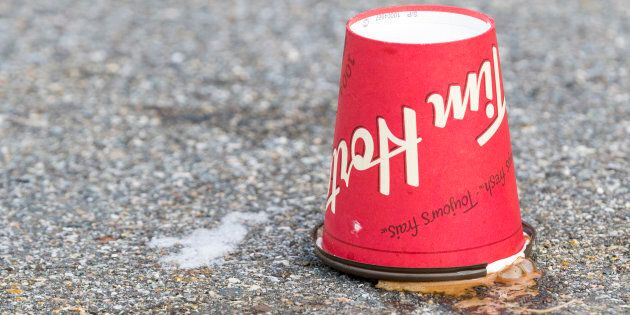 A discarded Tim Hortons coffee cup rests upside down in a parking lot in Saint John, N.B., Jan. 16,