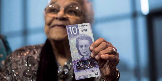 Wanda Robson holds the new $10 bank note featuring her sister Viola Desmond during a press conference...