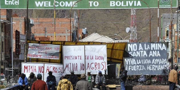 In this file photo taken May 24, 2011, Peruvian protesters block a bridge connecting Peru and Bolivia in Desaguadero, Peru, to oppose to the Canadian-owned Santa Ana silver mining project they said would pollute nearby lakes and rivers.