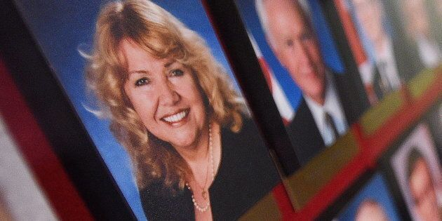 A picture of Sen. Lynn Beyak accompanies other senators' official portraits on a display in Centre Block...