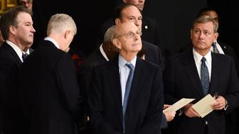 Supreme Court Associate Justices from left Brett Kavanaugh, Neil Gorsuch, Stephen Breyer, Associate Justice Samuel Alito Jr., rear, and Chief Justice John Roberts, right, wait for the casket of former President George H.W. Bush to arrive at the Rotunda of the Capitol, Monday, Dec. 3, 2018 in Washington.  (Brendan Smialowski/Pool via AP)