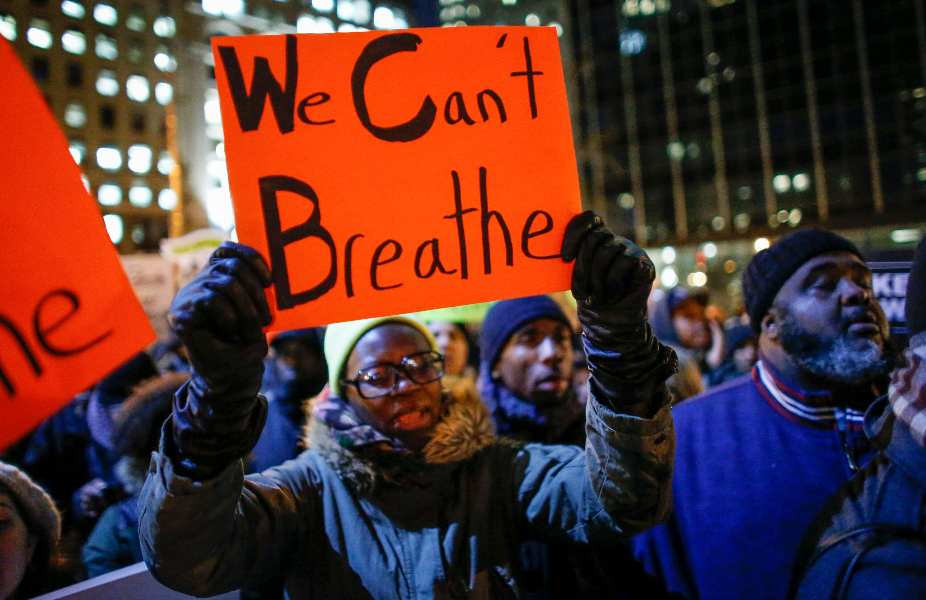 NEW YORK, NY - DECEMBER 4:  A woman holds a sign as she takes part in a protest following yesterday's decision by a Staten Island grand jury not to indict a police officer who used a chokehold in the death of Eric Garner in July, in Foley Square on December 4, 2014  in New York City.  The grand jury declined to indict New York City Police Officer Daniel Pantaleo in Garner's death.  (Photo by Kena Betancur/Getty Images)