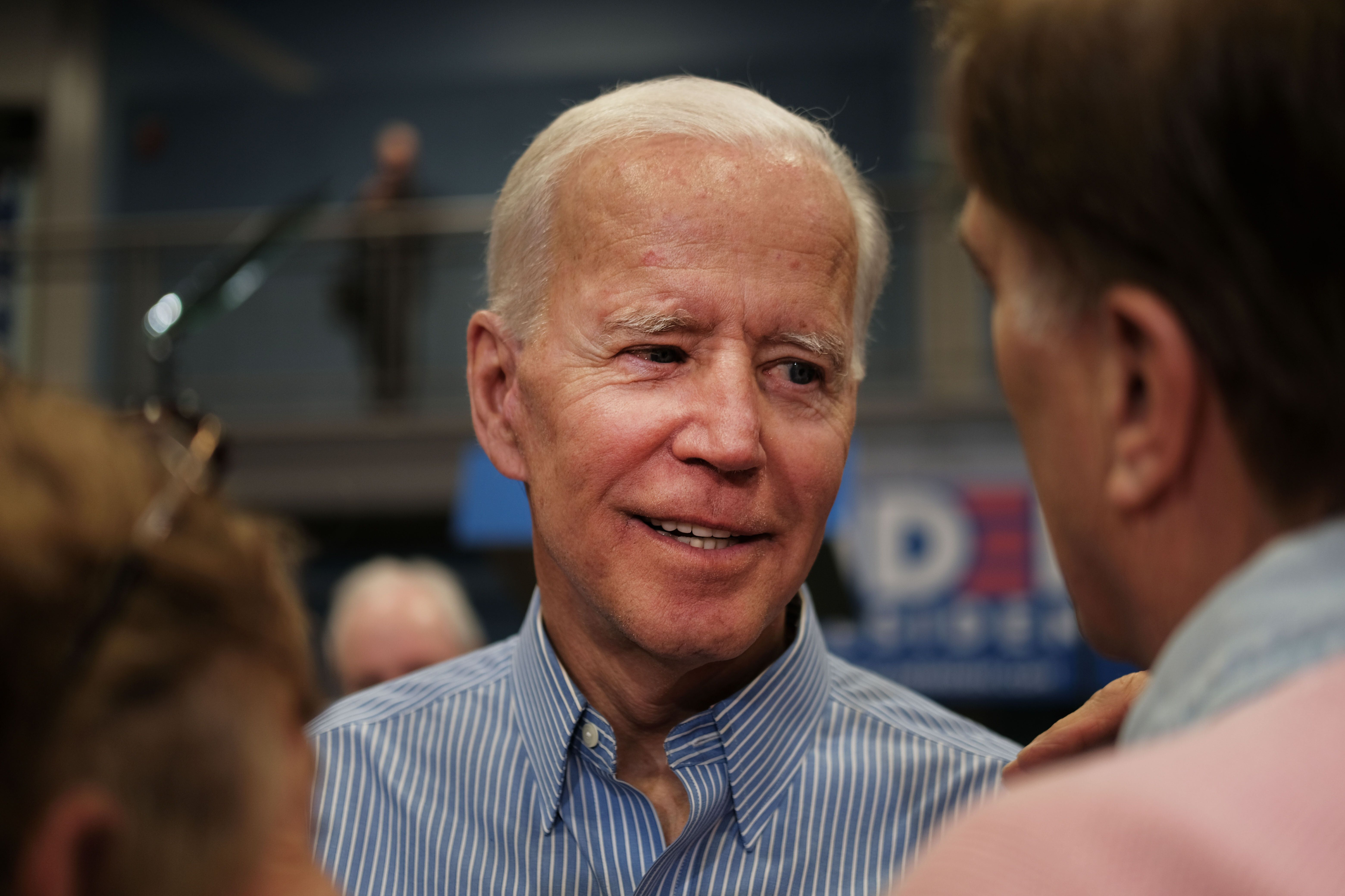 Former Vice President Joe Biden (D) greets voters in Manchester, New Hampshire, on Monday night.