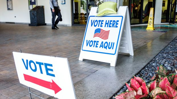 Miami Beach, polling, voting station, Vote Here Sign. (Photo by: Jeffrey Greenberg/UIG via Getty Images)