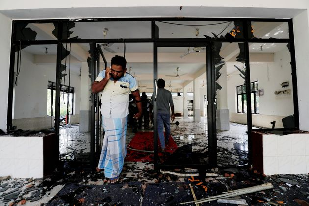 A Muslim man reacts inside the Abbraar Masjid mosque after a mob attack in Kiniyama, Sri Lanka May 13,