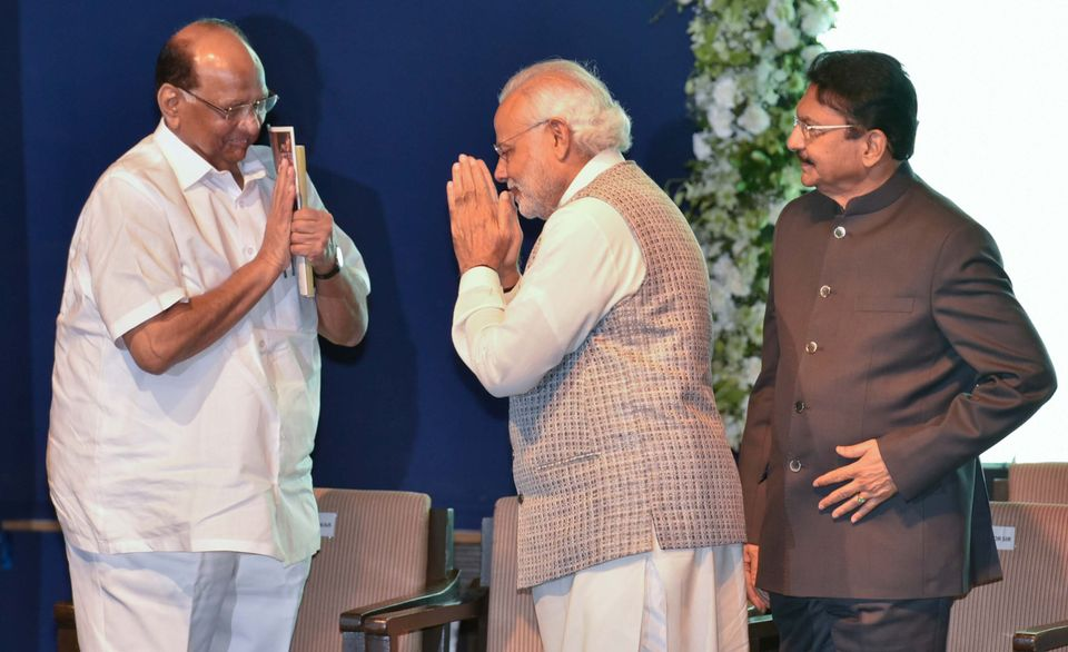 Rajya Sabha MP and veteran Maharashtra politician Sharad Pawar with Prime Minister Narendra Modi in a...