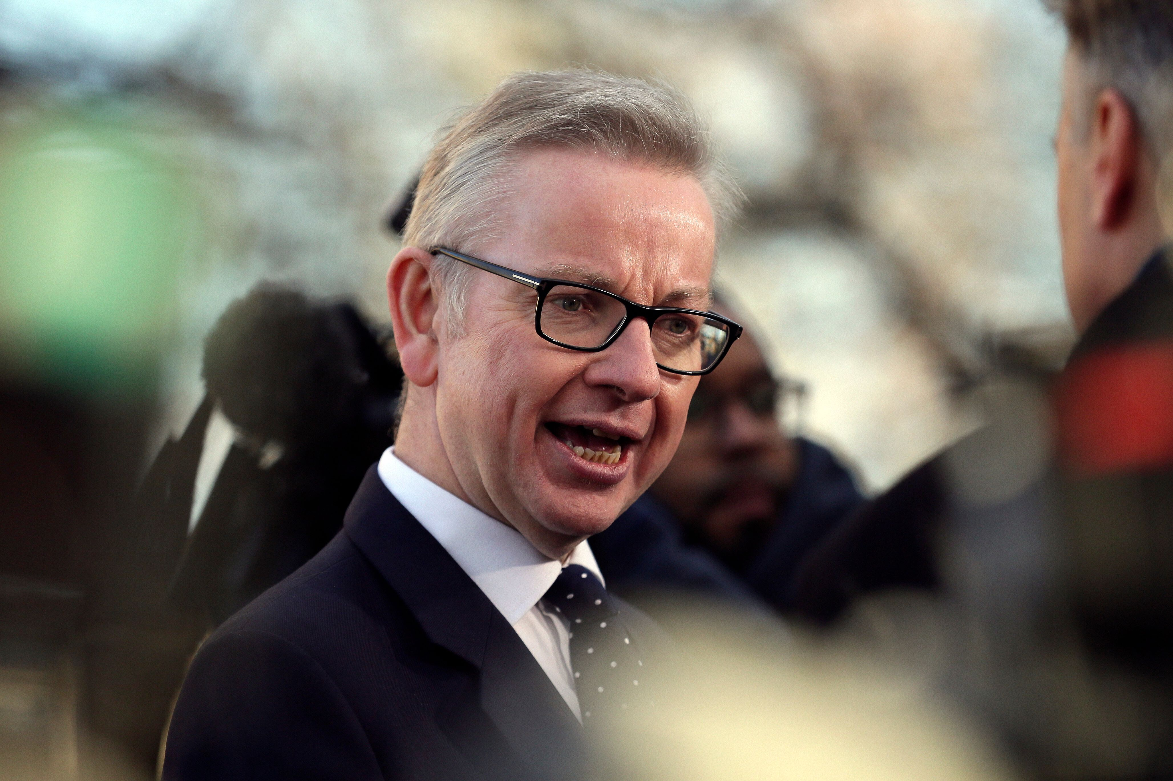 Britain's environment secretary Michael Gove speaks to the media outside the Houses of Parliament, in London, Wednesday December 12, 2018. British Conservative lawmakers forced a no-confidence vote in Prime Minister Theresa May for Wednesday, throwing U.K. politics deeper into crisis and Brexit further into doubt. (AP Photo/Tim Ireland)