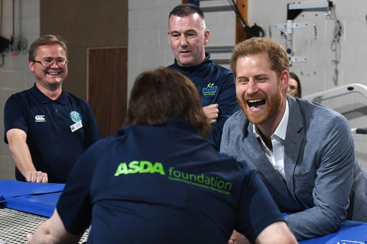 Prince Harry interacts with a participant of the Rebound Therapy session as he visits the Oxsrad Disability Sports and Leisur