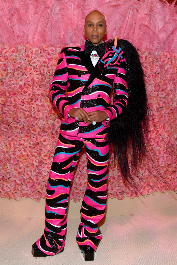 RuPaul attended the 2019 Met Gala in a pink and black sequined suit, designed by Zaldy.