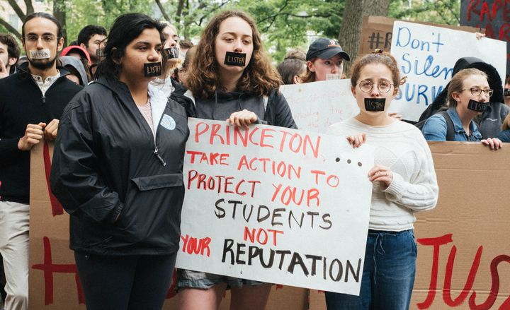 Princeton University students stage a silent protest in front of the president's office.