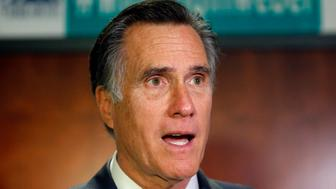 U.S. Sen. Mitt Romney, R-Utah, speaks with reporters after visiting with local officials to discuss how the four-week partial government shutdown is impacting an area with several major federal employers, including the Internal Revenue Service, Friday Jan., 18, 2019, in Ogden, Utah. (AP Photo/Rick Bowmer)