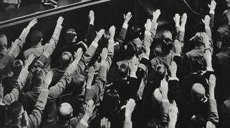 Adolf Hitler being saluted during an extraordinary session of the Reichstag at the Kroll Oper in Berlin, Germany, from L'Illustrazione Italiana, Year LXVI, No 34, August 20, 1939.