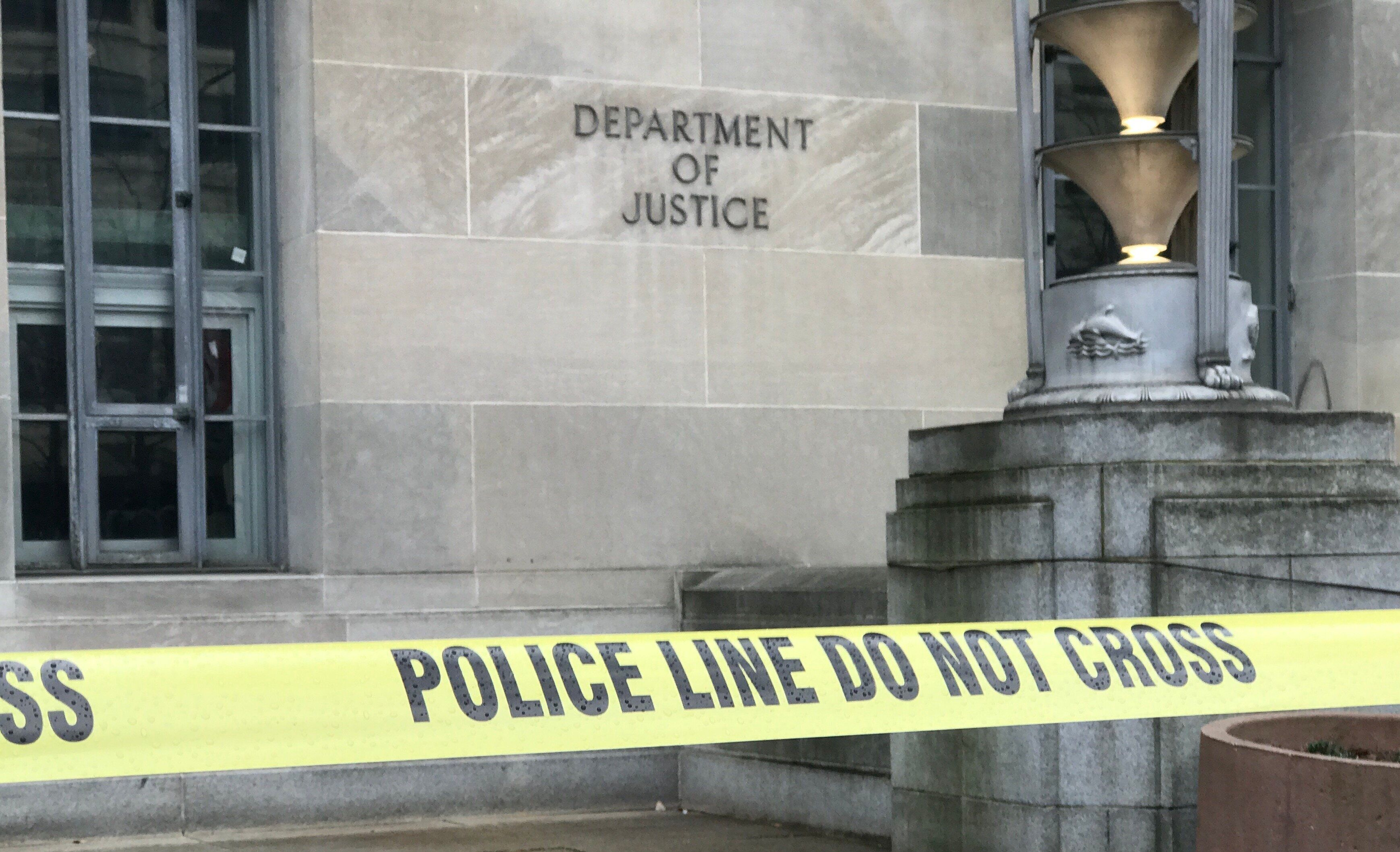 Police tape in front of Justice Department headquarters