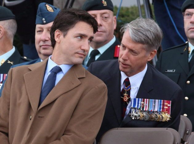 Justin Trudeau speaks with Andrew Leslie prior to a ceremony at the National War Memorial in Ottawa on Oct. 22, 2015
