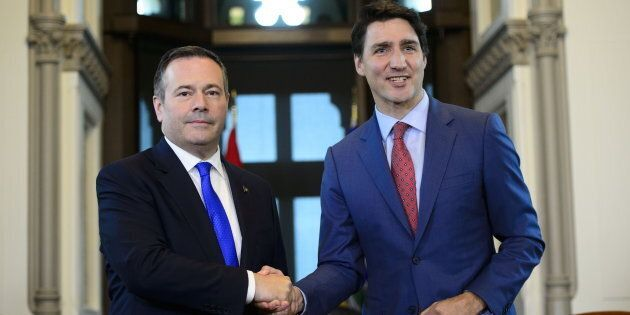 Prime Minister Justin Trudeau shakes hands with Alberta Premier Jason Kenney in his office on Parliament...