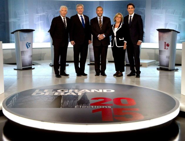 Flashback — From to left to right, former Bloc Quebecois leader Gilles Duceppe, ex-Conservative leader Stephen Harper, ex-NDP leader Tom Mulcair, Green Party Leader Elizabeth May and Liberal Leader Justin Trudeau pose for photos before the French-language leaders' debate in Montreal on September 24, 2015.