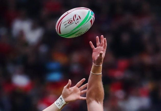 File photo of a player catching a rugby ball.
