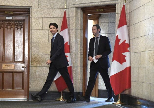 Prime Minister Justin Trudeau leaves his office with Gerald Butts to attend an emergency cabinet meeting on Parliament Hill on April 10, 2018.