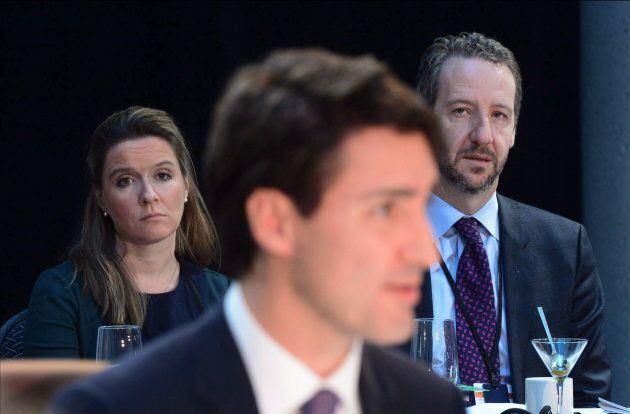 The prime minister's chief of staff Katie Telford and Gerald Butts look on as Prime Minister Justin Trudeau...