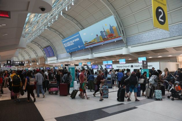Travellers at Toronto's Lester B. Pearson International Airport.