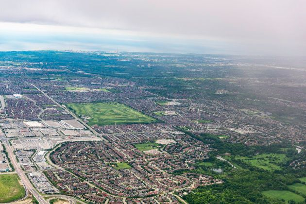 An aerial view of suburban subdivisions in Greater