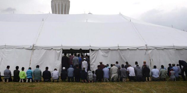 Worshippers take part in afternoon prayers on the last Friday of Ramadan at the Baitul Islam Mosque in Vaughan, Ont., prior to Canada Day festivities on July 1, 2016.